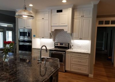 custom kitchen cabinets with a gray kitchen island