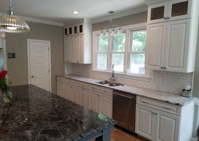 white perimeter kitchen cabinets with a gray kitchen island